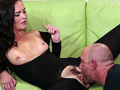 She is wearing a hot pantyhose bodysuit with some holes in proper places. She sucks her man's huge cock and then he owns her.