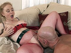 Huge cock sliding through her sexy red pantyhose while mature model enjoys harsh hardcore is appealing and unique