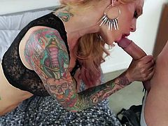 Smoking hot blonde tramp with tattoos all over her arms and back Sarah Jessie slurps on fat dick giving amazing sloppy blowjob.