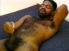 Bearded black gay bear is having a great time with his BF. The dudes fondle each other and have sex in the missionary position and doggy style.