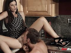 Witness this video where a brunette MILF, with a nice ass wearing a sexy dress, gets fucked hard by a lusty boy and moans loudly in a hot story.