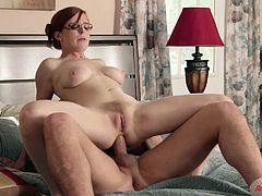 Touch yourself as you watch this redhead MILF, with giant boobs and a hairy pussy, while she goes hardcore and rides in the reverse cowgirl position.