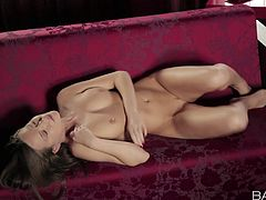 Gorgeous brunette Sibul Arch is totally naked on the couch and touches herself with passion. She puts her hands on her amazing tits and rubs her pink pussy with legs apart in erotic manner.