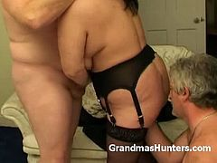 Make sure you don't miss this chubby amateur granny in the middle of a nasty threeway with two old guys. She shows her big juggs and starts to blow two cocks.