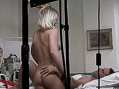 Turned on experienced blonde nurse Lucy Heart with juicy body in devilish red uniform and high heels gives head to patient in bed and rides on his stiff pecker in hardcore fantasy.