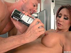 Take a look at this hardcore scene where the busty redhead Monique Alexander is fucked by one of her employees in her kitchen.