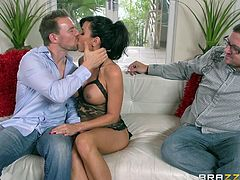 Touch yourself as you watch this brunette MILF, with big fake tits wearing sexy lingerie, while she gets badly screwed by a kinky man over a couch.