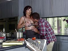 Brunette milf gives a terrific deepthroat blowjob in the kitchen