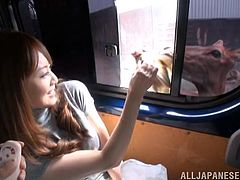 A kinky Japanese girl gets seduced in a bus. She lifts a skirt up and gets her bushy cunt toyed with a g-spot vibrator. Akiho also gets her dripping pussy fingered.