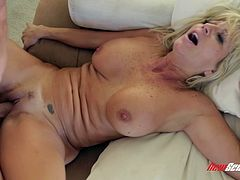 Entertain yourself by watching this blonde cougar, with big love pillows and a nice ass, while she goes hardcore with a crazy boy.