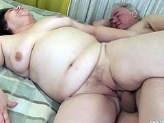 Grandpa caresses the cougar's big tits before she gives his hard horny dick a blowjob then gets on top to ride him as she screams and cums on her tits