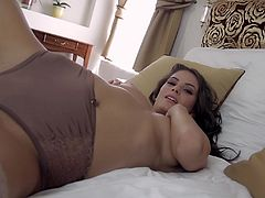 Beautiful Cosmo poses for a camera in a lingerie and stockings. This beauty lies on a bed touching her tits and an ass. This video is worth to see.