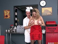 Big-breasted blonde milf Katie Kox is getting naughty with lewd cook Jessy Jones in the kitchen. Jessy oils Katie's big fake tits, then they bang doggy style and in other positions.