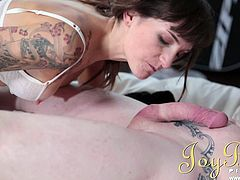 A tattooed housewife vacuums the living when she's called in the bedroom where a shirtless man expects her on the white mattress. The slutty milf undresses to show her nice tits and horny cunt, letting herself fingered and licked. Enjoy watching her while sucking well the guy's dick. Click to see!