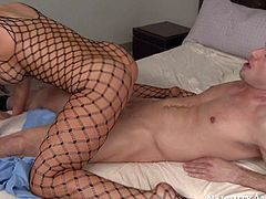 Big boobed Audrey Bitoni in sexy black fishnet bodystocking gives headjob to lucky dude in 69 position before he makes his cock disappear in her shaved puffy pussy. Watch passionate buxom brunette bounce up and down on throbbing dick and cant get enough.
