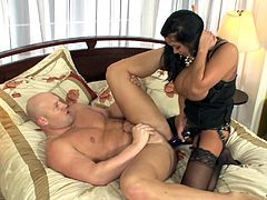 Check this brunette femdom, with gigantic love pillows wearing sexy stockings, while she gets banged hard and pegs a guy with a strapon.