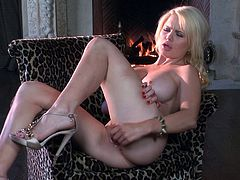 Press play on this amazing solo scene where the beautiful blonde Alexis Ford masturbates as a raging fireplace burns in the background.