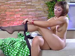 Amelia sits naked on the bed and puts on a pair of black pantyhose, followed by a green dress. They fit perfectly on her legs and on her ass cheeks as well.