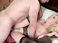 This blonde looks absolutely perfect while wearing sexy lingerie set with pantyhose and garters. Sexually charged nympho rides her husband's dick like a true cowgirl. Then he fucks her tight pussy from behind.