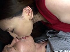 Press play on this hot scene and watch the beautiful Japanese babe Sayuki Kanno sucking on this guy's hard cock as well as titty fucking him with her big natural tits.