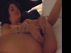 This insanely horny brunette never gets enough of her pretty pussy and neither do we. Judging by the noises she makes you can tell that she is having a good time in her bedroom.