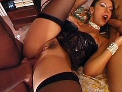 A brunette girl in a corset and stockings strokes and sucks two big dicks. Then Jessica gets rammed in both holes simultaneously.