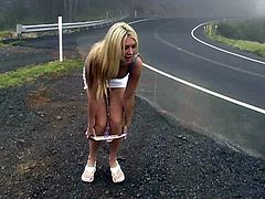 Be part of this solo model video where a blonde babe, with big boobs wearing a miniskirt, while she takes her panties off in public.