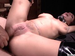Readhead in leather outfit catches fire with a dick pounding both her holes. She gets facialized and swallows like a nice girl.