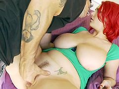 Gorgeous red haired babe has got huge natural boobs. She gets her pussy fingered before sucking big dick greedily. Then she is hammered bad in a missionary position.