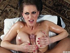 Sexy brunette Eve Laurence shows her big fake tits to Johnny Sins and lets him oil and massage her body. Then Johnny licks Eve's smooth pussy and drills it doggy style.