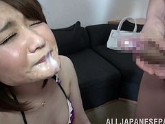 What are you waiting for? Watch this Japanese brunette, with small boobs wearing a cute bra, while she sucks a big pole and gets a cumshot in her mouth.