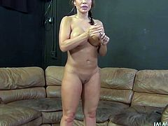 Extra voluptuous mommy with braided hair walks around the room wearing only slutty high heel shoes. Watch her big booty and heavy rack jiggle!
