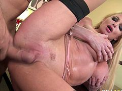 At fist she swallows his dick and plays with her fake big boobs. Then she gets her pussy fucked missionary style by her horny boss. Click here and enjoy watching busty babe in action.