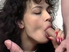 Insatiable and filthy brunette in sexy stockings stands on knees and sucks that hot blooded cock with passion. Have a look at that awesome BJ in The Classic Porn sex clip!