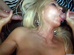 Hussy blonde mamma with big tits fucks hard in dirty gangbang action. She sucks solid cock while getting nailed missionary style.