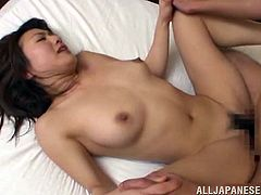 A blindfolded and gagged Japanese MILF gets her pussy fingered. After that she gets fucked so hard that she screams with pain.