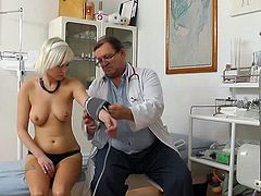 With the boobs exposed and her panties ready to come off, horny doc starts to examine her fresh twat