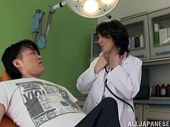Slutty Japanese doctor Rei Aimi is examining a guy's cock. She sucks it to look whether it works right, and also pleases the man with a rimjob.