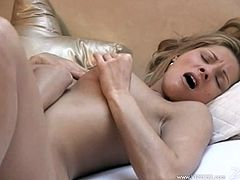 Gorgeous blondes lick each others nice pussies. They also lick silver dildos and drill their cunts lying on a bed.