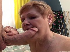 Cougar mature woman in black stockings enjoys sucking big cock. She licks penis head and sends it deep in her throat. Then young dude fucks her old pussy missionary style from behind.