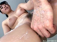 A Japanese girl washes a guy in a bathroom. Of course he starts to touch Ai's pussy and boobs. Then this babe gives a blowjob and gets fingered. She also gets her mouth filled with cum.