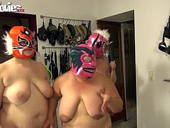 This hot chick is going to make these ugly fuckers get nasty for her amusement. They are wearing masks and she makes them like her cunt and play with her boobs. The mistress watches as the fat bitches fuck each other with strap on dildos.