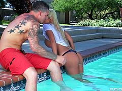 A sexy, young blonde with big, fake tits enjoys sucking her boyfriends' huge cock next to the swimming pool. Hear him moan with pleasure now!