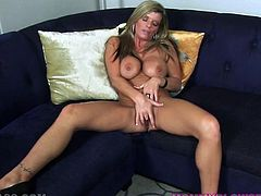 Delicious mommy with light hair and curvy body Krystal Summers takes off her tank top and tight jeans. Check out her big boobs and her jiggly butt while Krystal finger bangs her meaty snatch.