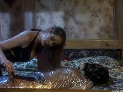 Sweet Alexia covers her slave in a mask then clips her boobs as she squeezes her hot ass then covers her in polythene as she runs a vibrator on her clitoris in a rough encounter