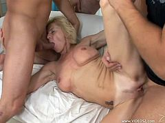 Share this with your friends! A mature lady, with a nice ass wearing jeans, goes extremely hardcore with horny dudes over a couch.
