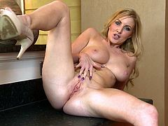 Sizzling blonde milf Georgie Lyall is having a nice time alone. She strips and demonstrates her terrific natural boobs, then strokes her hot body and pleases herself with fingering.