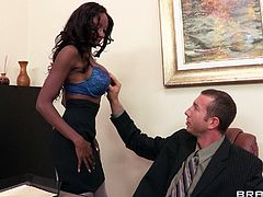 Busty black skank Diamond Jackson is having fun with Jordan Ash indoors. She sucks his dick hungrily, then they bang in the missionary position on a desk.