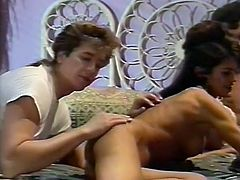 Dark haired seductive chick with gorgeous shapes sucks sugary penis of one guy. Meanwhile the other freak eats her moist and thirsting pussy with passion. Just look at that dirty 3 some in The Classic Porn sex clip!