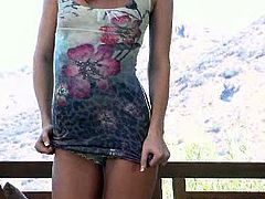 Tori Black teases with a short dress on